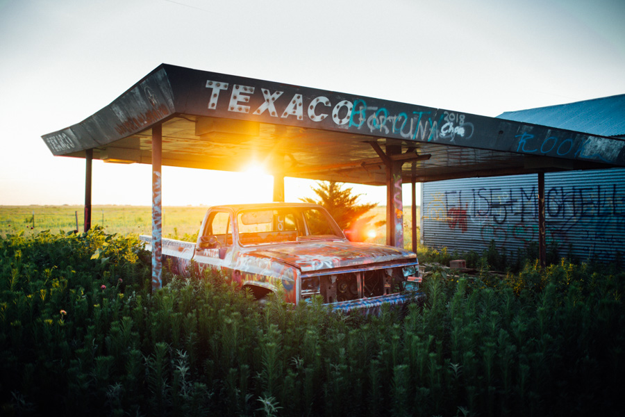 Sunset behind an abandoned truck in Texas